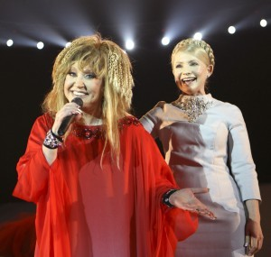 Russian pop singer Pugacheva and Ukraine's Prime Minister Tymoshenko greet audience during concert in Kiev